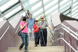 User descending stairs in site visit as part of accessibility code revision
