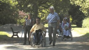 Walkers including mobility-impaired people on an outdoor path