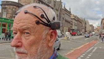 Man wearing portable neural imaging headset in Edinburgh